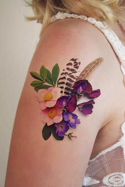 Flowers And Feathers Tattoo